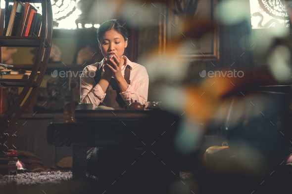 Young asian woman drinking tea - Stock Photo - Images