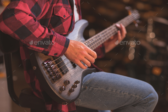 Young musician with a guitar - Stock Photo - Images