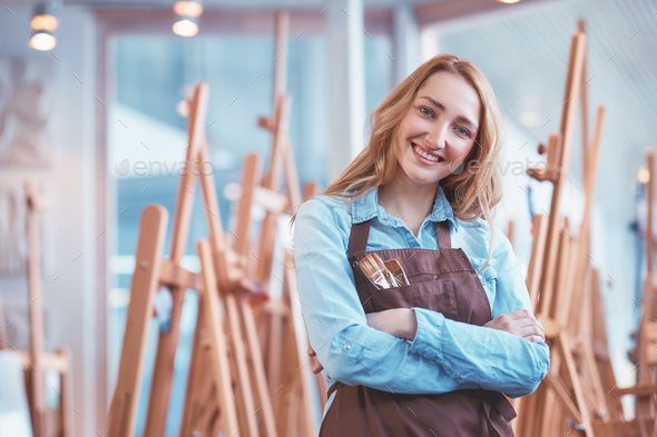 Attractive young artist with easels - Stock Photo - Images