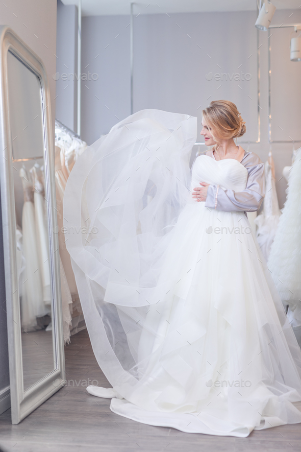 Attractive young bride in the store - Stock Photo - Images