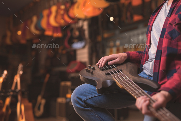 Young musician with a guitar closeup - Stock Photo - Images