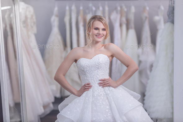 Smiling young bride in white dress - Stock Photo - Images