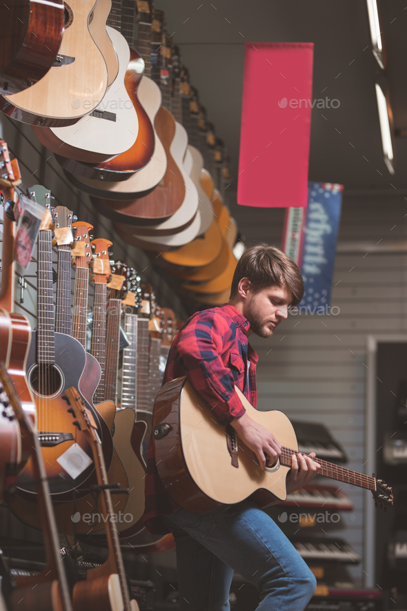 Young man playing the guitar - Stock Photo - Images