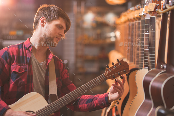 Young musician playing the guitar - Stock Photo - Images