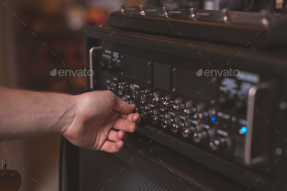 Man's hand atthe music panel - Stock Photo - Images
