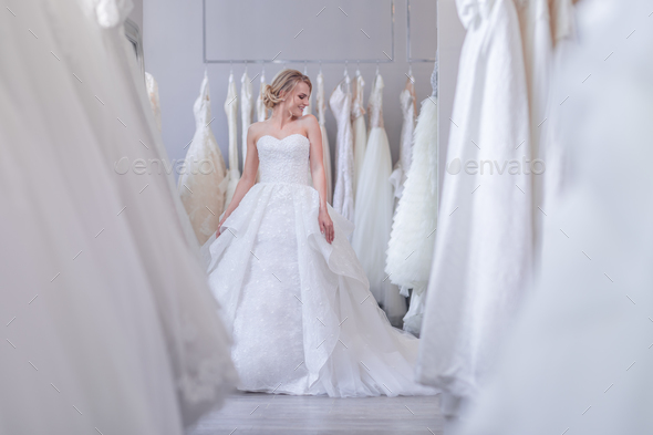 Attractive young bride in white dress - Stock Photo - Images