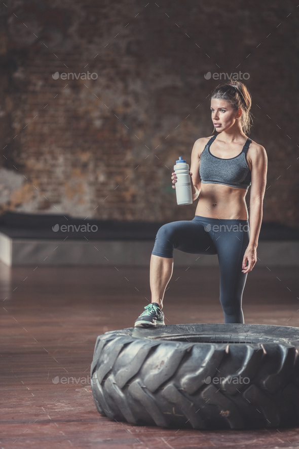 Sports woman with a bottle at workout - Stock Photo - Images