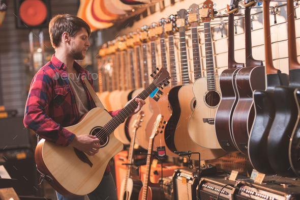 Young man in the store - Stock Photo - Images