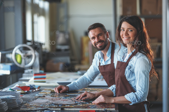 Smiling young people at work - Stock Photo - Images