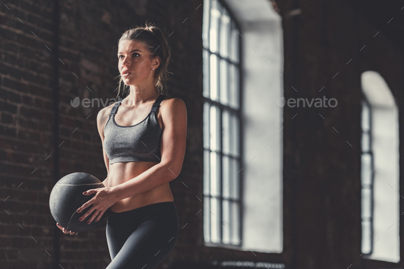 Sporty girl with a ball - Stock Photo - Images