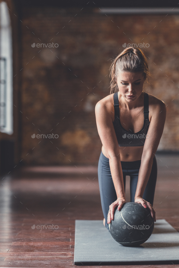 Athletic young girl at workout - Stock Photo - Images