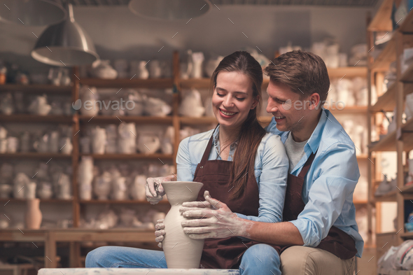 Smiling couple with a potter's wheel - Stock Photo - Images