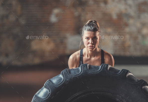 Young girl with a crossfit wheel - Stock Photo - Images
