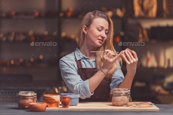 Young girl in pottery - Stock Photo - Images