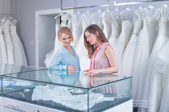 Young seller and a customer in a shop - Stock Photo - Images