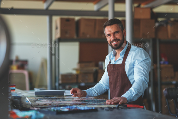Smiling master in studio - Stock Photo - Images
