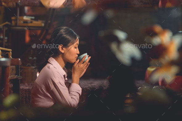 Young asian girl drinking tea - Stock Photo - Images