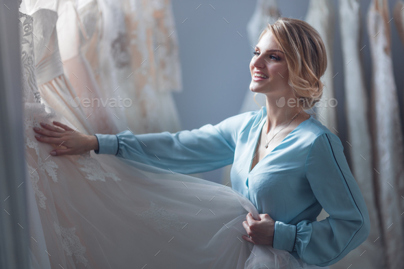Young attractive girl chooses a wedding dress - Stock Photo - Images