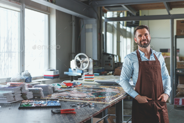 Smiling man in workshop - Stock Photo - Images