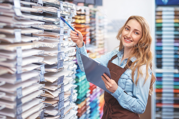 Smiling young girl in the store - Stock Photo - Images