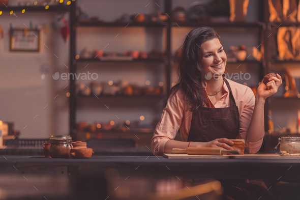 Attractive girl at work in pottery - Stock Photo - Images