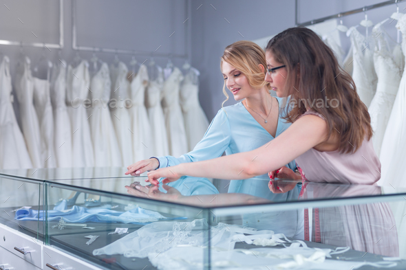 Young seller and a customer - Stock Photo - Images