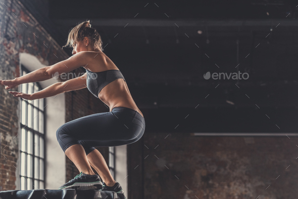 Jumping sports woman indoors - Stock Photo - Images