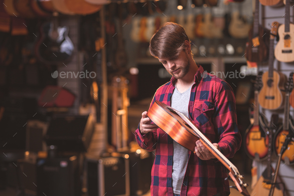 A young man with an ukulele - Stock Photo - Images