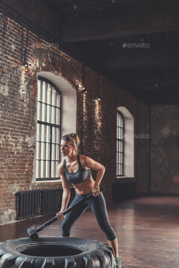 Sports woman with a sledgehammer - Stock Photo - Images