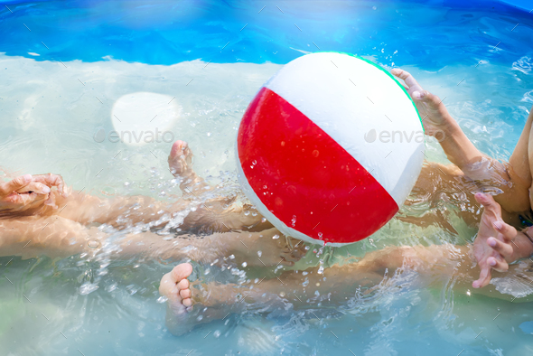 Kids playing at outdoor swimming pool. Little girl and boy play and swim in a home inflated pool - Stock Photo - Images