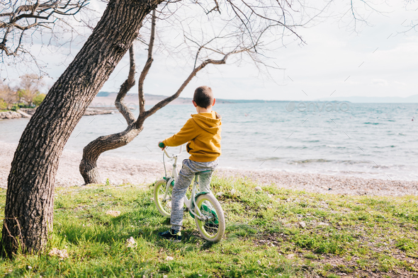 Boy on his bike - Stock Photo - Images