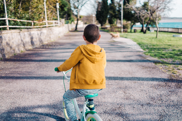 Boy riding bycicle - Stock Photo - Images