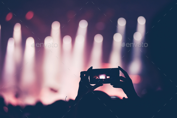 Close up of smart phone recording video during a live concert - Stock Photo - Images