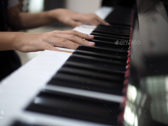 Child hand on piano keys - Stock Photo - Images