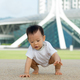 Asian baby boy crawling in park - PhotoDune Item for Sale
