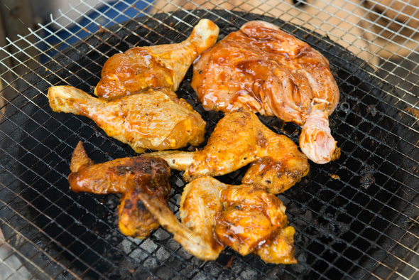 BBQ chicken meat roasted on hot flaming charcoal grill - Stock Photo - Images