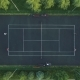 Players Play Tennis on a Green Court. Aerial Vertical Top-Down View - VideoHive Item for Sale