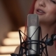 Beautiful Young Woman Recording a Song in a Professional Studio. Sexy Girl Posing and Dancing - VideoHive Item for Sale