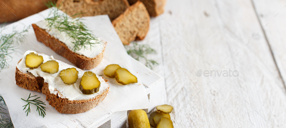 Sandwiches with cream cheese, dill and salted cucumber - Stock Photo - Images