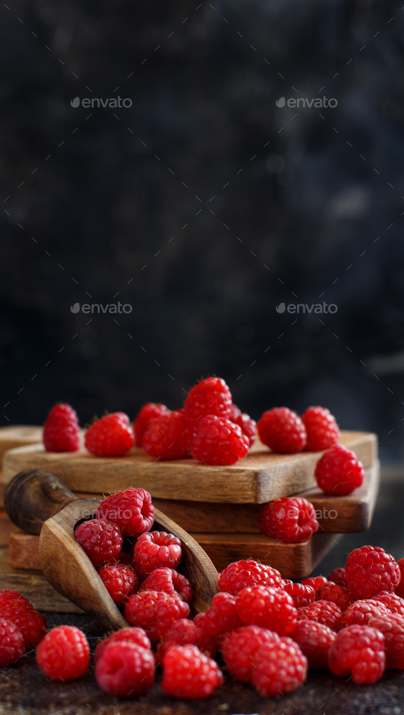 Fresh raspberries on a dark background - Stock Photo - Images