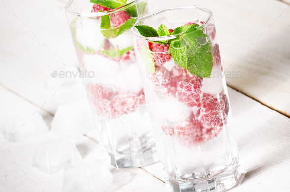 Raspberry Fruit Water with ice and mint on white table - Stock Photo - Images
