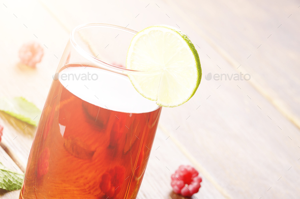 Lime and Mint raspberry Fruit Beer on wooden table - Stock Photo - Images