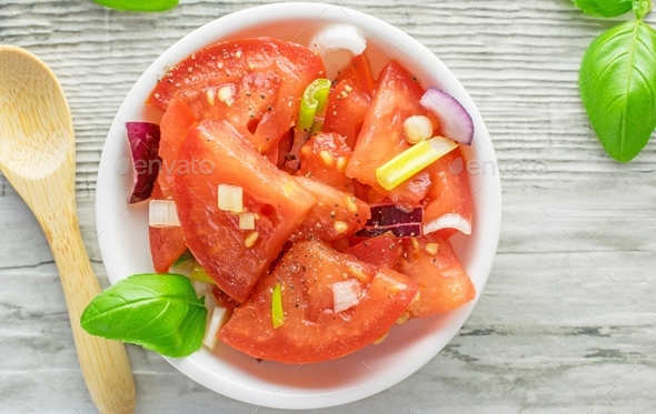 A fresh tomato and onion salad - Stock Photo - Images