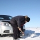The Driver Digs Out the Car with a Shovel From the Snow - VideoHive Item for Sale