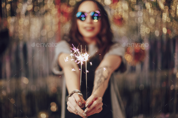 Woman hands holding sparklers - Stock Photo - Images