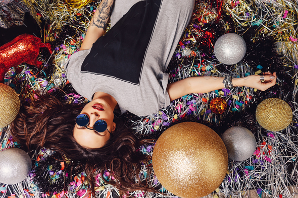Glamorous party girl wearing sunglasses - Stock Photo - Images