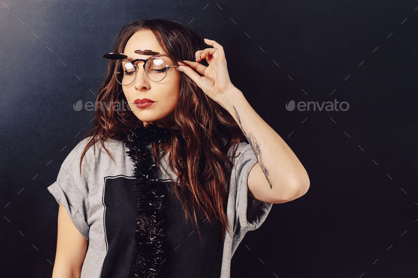 Portrait of seductive hipster girl wearing glasses - Stock Photo - Images