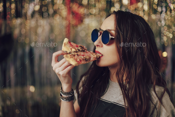 Girl eating tasty pizza - Stock Photo - Images