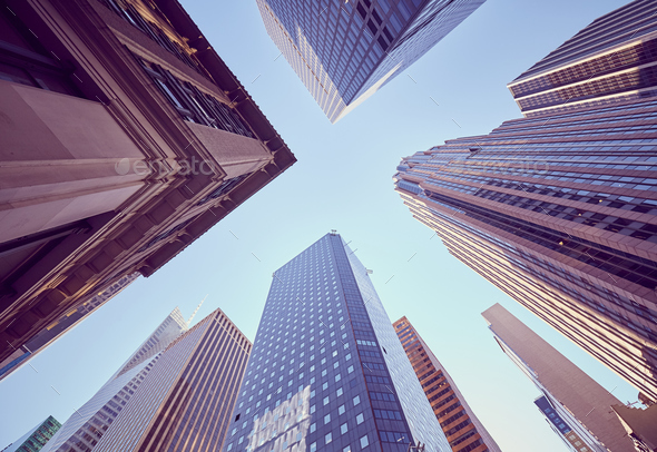 Looking up at New York skyscrapers at sunset, USA. - Stock Photo - Images