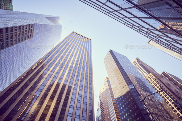 Looking up at Manhattan skyscrapers at sunset, NYC. - Stock Photo - Images